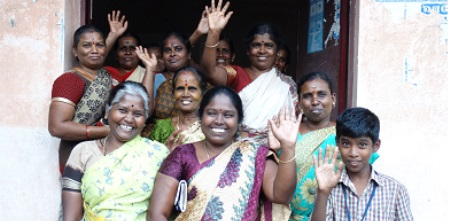 A group of people who have joined the micro pension scheme waiving at the camera