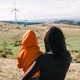 Women looking at wind turbines