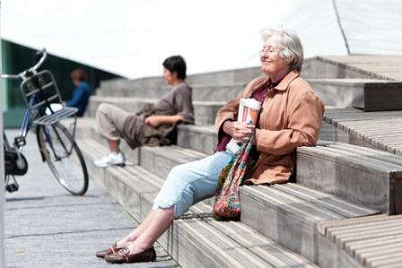 older woman sitting on steps
